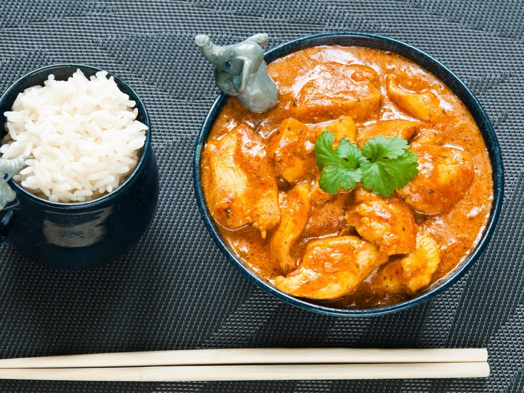 Chicken curry with rice and chopsticks
