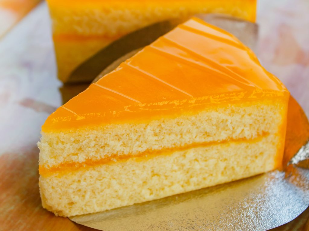 Butter cake with orange topping, homemade cake very yummy.
