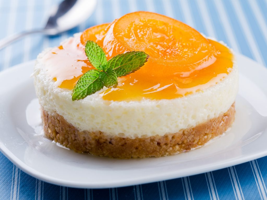 Close up of a vanilla and orange cheesecake